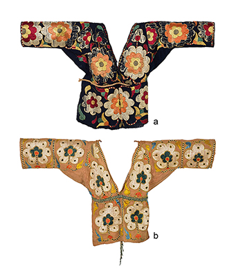CHAMBA BODICE WITH LARGE FLORAL MOTIFS CHAMBA, HIMACHAL PRADESH, LATE 19TH CENTURY a) Handspun and handwoven cotton embroidered with untwisted silk, double-sided hand embroidery, natural dyes Length 16.75 in (43 cm), Sleeve span 30.5 in (78 cm) b) Handspun and handwoven cotton embroidered with untwisted silk, double-sided hand embroidery, natural dyes Length 15.5 in (40 cm), Sleeve span 27.5 in (70 cm) (Set of two)